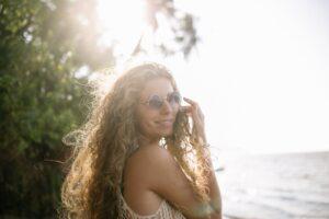 woman in white tank top wearing aviator sunglasses